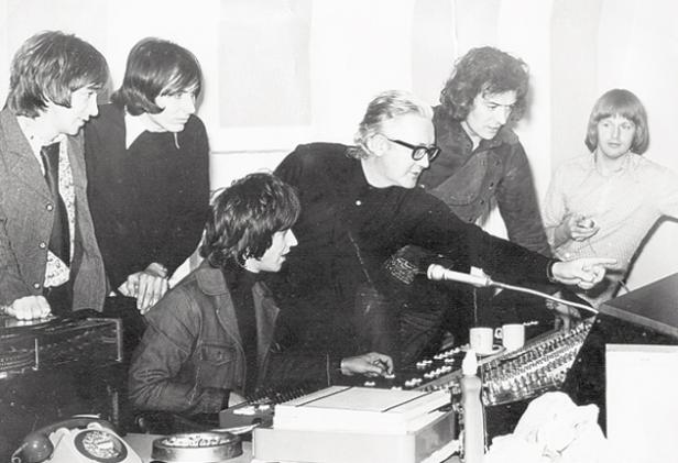 A schoolmasterly approach: Richards, centre, wearing glasses, with the Hollies in the studio in the early 1970s